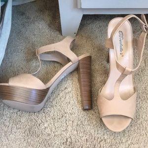 Breckelle's nude peep toe pumps
